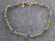 Peridot and Tanzanite wire sculpted argentium silver bracelet